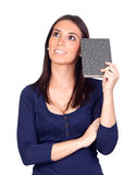 Beautiful girl thinking with a book Stock Photography
