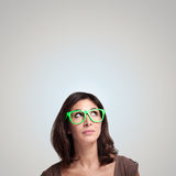 Beautiful girl thinking with green eyeglasses Royalty Free Stock Photo