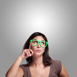 Beautiful girl thinking with green eyeglasses Royalty Free Stock Photos