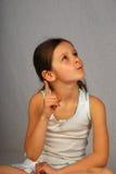 Beautiful girl thought isolated Stock Image