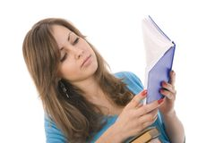 Beautiful girl thoughtfully reading a book Royalty Free Stock Photos