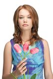 Beautiful girl with three tulips Stock Photo