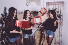 Beautiful girl throw up Christmas gifts. Decorative vintage apartment. cookies royalty free stock image