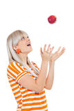 Beautiful girl throwing an apple Royalty Free Stock Photos