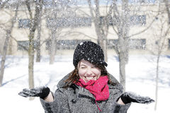 Beautiful girl throwing snow in the air Royalty Free Stock Photo