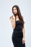 Beautiful girl in a tight black dress, isolated on white backgro Royalty Free Stock Photos
