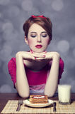Beautiful girl with toast and kefir. Royalty Free Stock Image