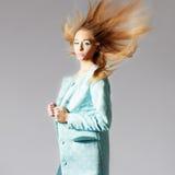 Beautiful girl in topcoat Stock Photography