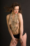 Beautiful girl topless with beads stock images