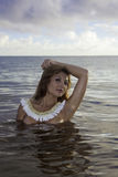 Beautiful girl topless in the ocean Royalty Free Stock Photography
