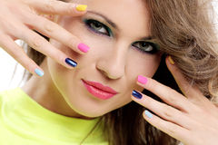 Beautiful girl touch her face with colored fingers Stock Images