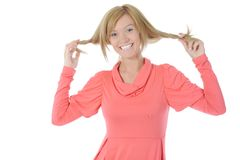 Beautiful girl touches her hair. Stock Photography