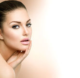 Beautiful Girl Touching her Face Royalty Free Stock Images