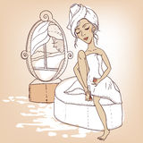 Beautiful girl with a towel on his head Stock Images