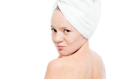 Beautiful girl in a towel looked back at the camera Stock Photo