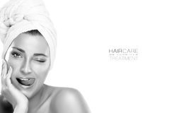 Beautiful Girl in Towel Winking with Funny Expression. Spa Woman Stock Photography