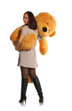 Beautiful girl with toy bear Stock Image