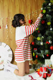 Beautiful girl with toy bear at Christmas tree Royalty Free Stock Photo