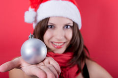 Beautiful girl with toy christmas ball Stock Photography
