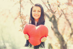 Beautiful girl with toy heart Royalty Free Stock Images