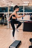 Beautiful young woman is training in a beautiful boxing hall royalty free stock photos
