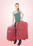 Beautiful girl with a travel bags. Over pink background Royalty Free Stock Photo