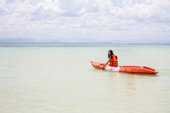 Beautiful Girl With  Travel and Vacation on The Beach enjoying Royalty Free Stock Images