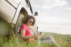 Beautiful girl traveling by car Royalty Free Stock Image