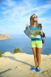 Beautiful girl traveling on mountain coast Royalty Free Stock Image