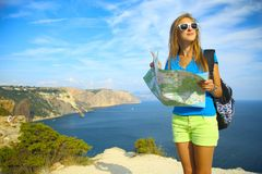 Beautiful girl traveling on mountain coast Royalty Free Stock Images