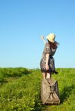 Beautiful girl travelling with a suitcase Royalty Free Stock Photo