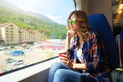 Beautiful Girl Travelling On Train. Rosa Khutor. Beautiful Girl Travelling On Train. Russia, Sochi, Rosa Khutor Stock Photography