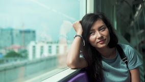 Beautiful girl travelling in underground. Beautiful young woman travelling in a train of underground and looking through the window stock video