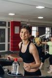 Beautiful girl on a treadmill Stock Image