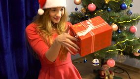 Beautiful girl treats her new year`s gift stock video