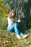 The beautiful girl at a tree Stock Images