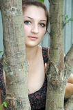 Beautiful girl among the trees Royalty Free Stock Image