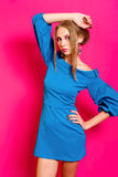 Beautiful girl in a trendy blue dress Royalty Free Stock Image
