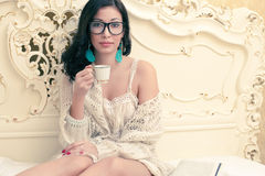 Beautiful girl in trendy eyewear drinking coffee Stock Photography