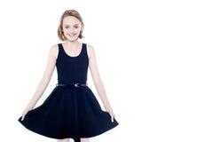 Beautiful girl in trendy sleeveless attire Stock Photo