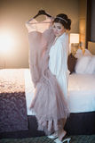 Beautiful girl tries on a pink wedding dress Royalty Free Stock Images