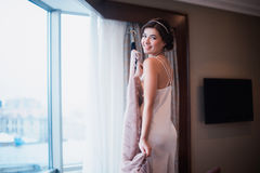 Beautiful girl tries on a pink wedding dress Royalty Free Stock Photos