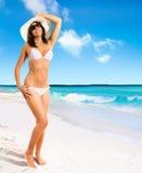 Beautiful girl on a tropical beach stock image
