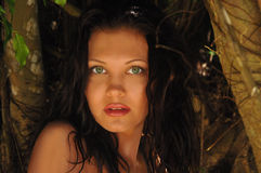 Beautiful girl in the tropical jungle Stock Image