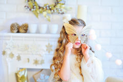 Beautiful girl trying on carnival mask Royalty Free Stock Images