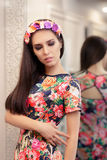 Beautiful Girl Trying on Floral Dress Royalty Free Stock Photo