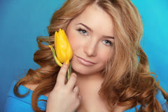 Beautiful Girl With Tulip Flower over Blue. Beauty Model Woman F Stock Images