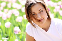 Beautiful girl with tulip flowers Royalty Free Stock Photo