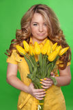 Beautiful Girl With Tulip Flowers over green background. Beauty. Model Woman Face Royalty Free Stock Photos