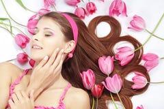 Beautiful girl with tulips Stock Photography
